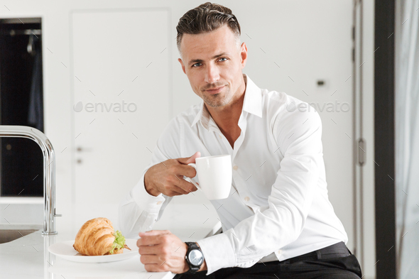 Handsome man dressed in formal clothes - Stock Photo - Images
