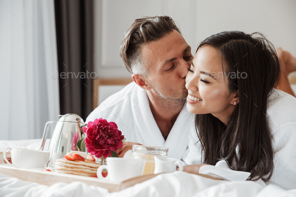 Lovely young couple dressed in bathrobes - Stock Photo - Images