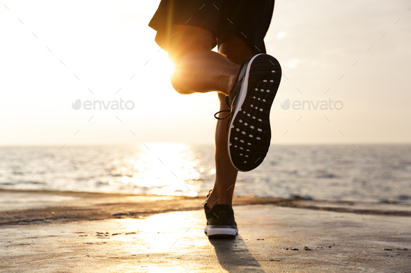 Cropped photo of active sporty man legs who wearing tracksuit an - Stock Photo - Images
