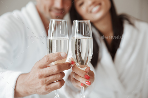 Blurry image closeup of caucasian handsome man and beautiful asi - Stock Photo - Images