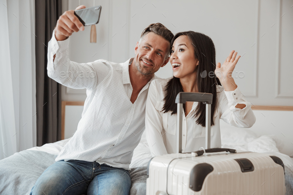 Happy young couple taking selfie with mobile phone - Stock Photo - Images