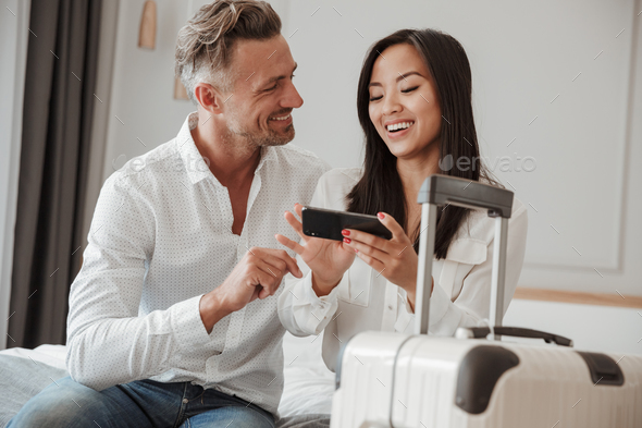 Image of pleased man and woman in casual clothing, staying at ho - Stock Photo - Images