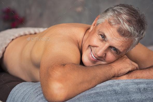 Senior man relaxing at spa - Stock Photo - Images