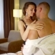 Naked Man and Woman Are Hugging To Each Other and Sitting on a Bed in Bedroom - VideoHive Item for Sale