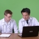 Two Multi-ethnic Doctors Together Against Green Background - VideoHive Item for Sale