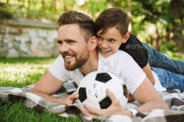 Happy young father with his little son with football - Stock Photo - Images