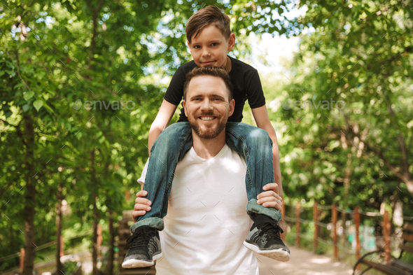 Happy young father have fun with his little son - Stock Photo - Images