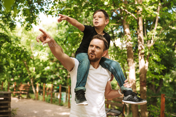 Concentrated young father have fun with his little son - Stock Photo - Images