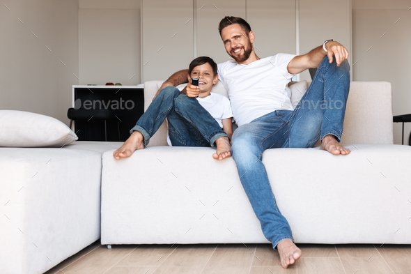 Handsome bearded man indoors at home with his son - Stock Photo - Images