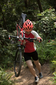 Cyclist carrying a mountain bike in the forest - PhotoDune Item for Sale