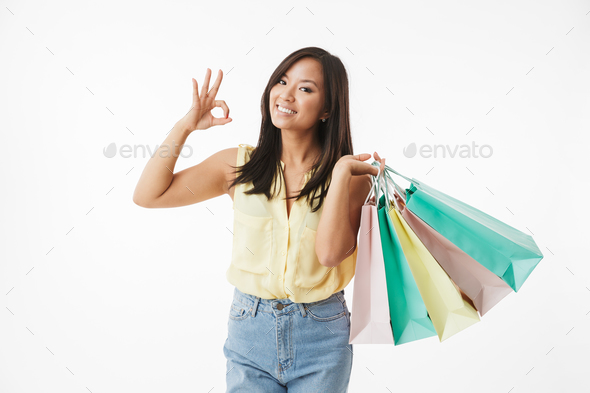 Happy emotional young asian woman make ok gesture. - Stock Photo - Images