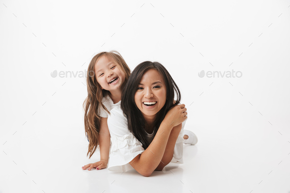 Cute young asian woman mother with her little daughter - Stock Photo - Images