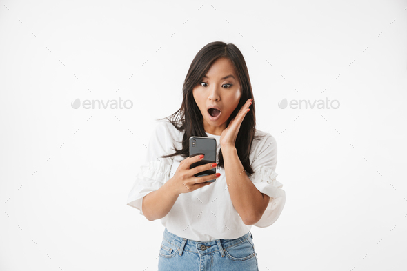 Image of shocked or surprised asian woman screaming and gesturin - Stock Photo - Images