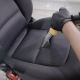 Person Cleaning Folds of Car Seat - VideoHive Item for Sale