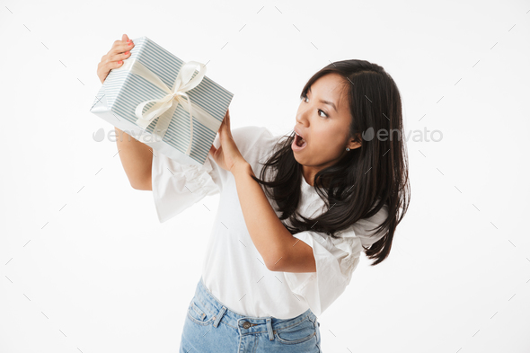 Image of excited asian girl with open mouth looking at present b - Stock Photo - Images
