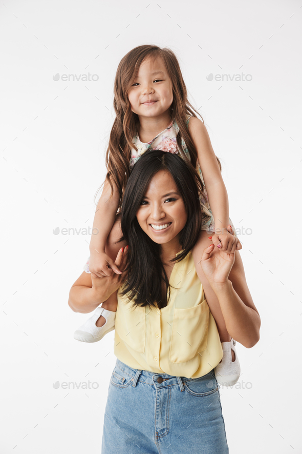Happy young asian woman mother with her little daughter - Stock Photo - Images