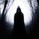 Monster silhouette in mysterious haunted forest on Halloween - PhotoDune Item for Sale