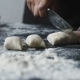 Women's Hands Cut the Dough Into Pieces with Kitchen Knife - VideoHive Item for Sale