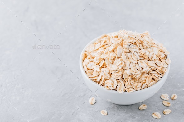Bowl with raw oatmeal (oat flakes) - Stock Photo - Images