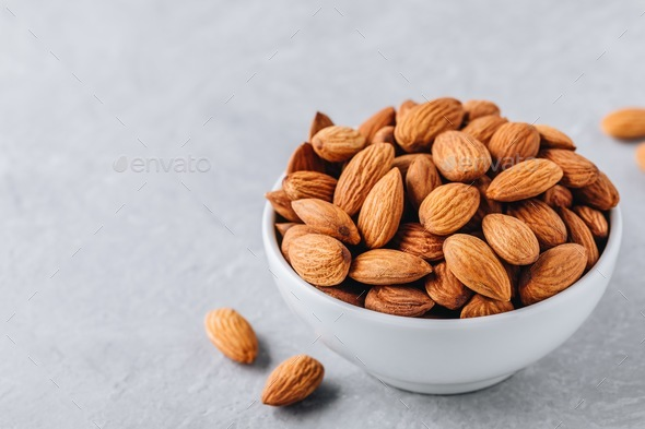 raw whole almond in bowl - Stock Photo - Images