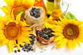 Yellow sunflowers with bottles of oil and a small bag of seeds o - PhotoDune Item for Sale