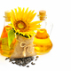 Sunflower and seeds in small bag and bottles of oil on white bac - PhotoDune Item for Sale
