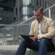 Man Sitting at Stairs and Using Tablet Pc - VideoHive Item for Sale