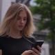 Woman Uses Her Cellular Phone - VideoHive Item for Sale