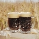Two Glasses of Dark Beer Stands on a Wooden Box in the Field - VideoHive Item for Sale