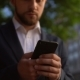 Bearded Man in Blue Suit Holding Smartphone - VideoHive Item for Sale