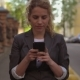 Charming Woman Going Along the Street and Using Her Mobile Phone - VideoHive Item for Sale