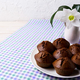 Plate of chocolate cupcakes and white flowers, copy space - PhotoDune Item for Sale