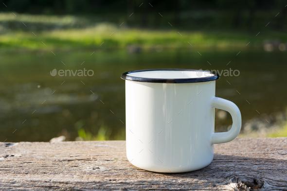 White campfire enamel mug mockup with sun beams - Stock Photo - Images