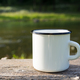 White campfire enamel mug mockup with sun beams - PhotoDune Item for Sale
