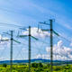 Three high voltage transmission towers over cloudy sky - PhotoDune Item for Sale
