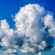 Cumulonimbus thunderstorm clouds over blue sky - PhotoDune Item for Sale