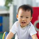 Little toddler Asian boy having fun on playground - PhotoDune Item for Sale