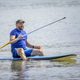 a bearded man paddling in the ocean - PhotoDune Item for Sale