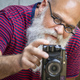 a bearded man taking a photograph - PhotoDune Item for Sale