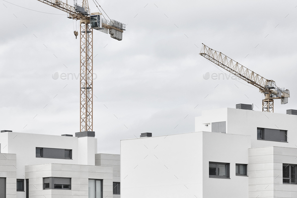 Modern building and crane machinery structure. Construction industry. Horizontal - Stock Photo - Images