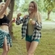 Beauiful Hipster Girls with Sunglasses Having Fun Making Bubbles in Park - VideoHive Item for Sale