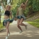 Cute Hipster Girls in Shorts Jumps in Park - VideoHive Item for Sale