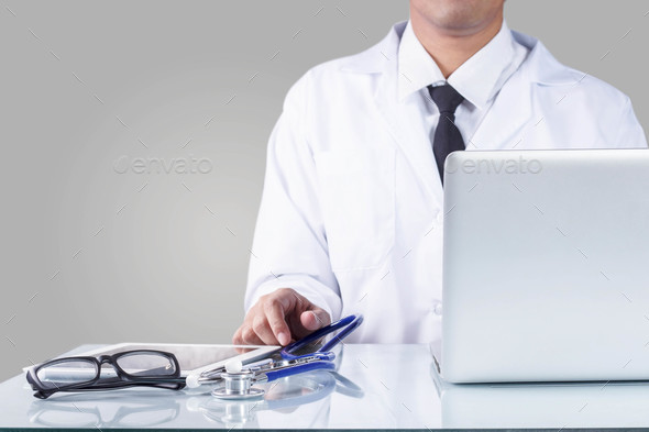 Doctor and equipment in office - Stock Photo - Images
