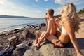 Couple enjoy cold ice cream at sunny beach - PhotoDune Item for Sale