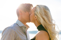 Kissing couple in romantic embrace on beach at summer - PhotoDune Item for Sale