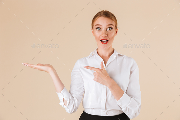 Young business surprised woman pointing. - Stock Photo - Images