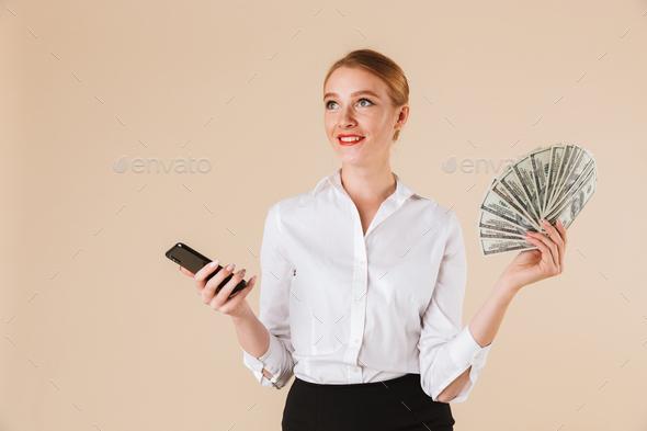 Portrait of a happy businesswoman showing money - Stock Photo - Images