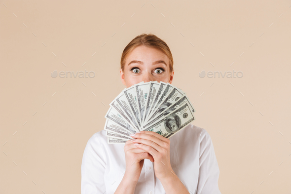 Portrait of an excited businesswoman showing money - Stock Photo - Images