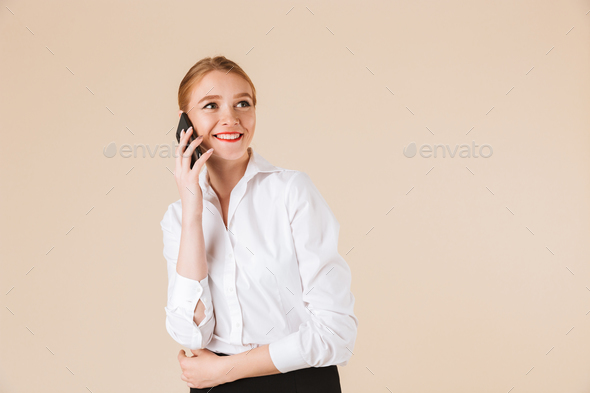 Happy young business woman talking by mobile phone. - Stock Photo - Images