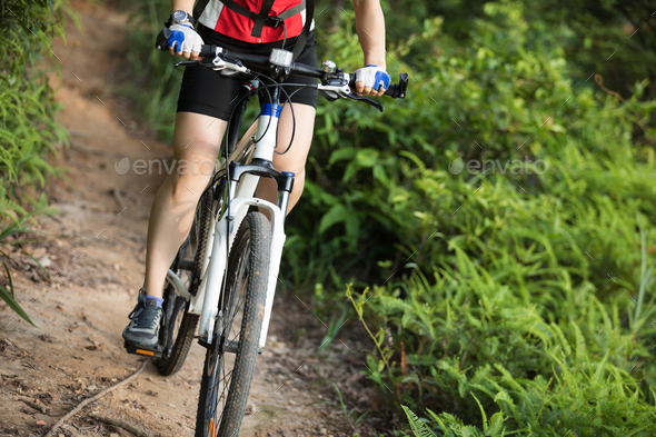 Riding bike on mountain trail - Stock Photo - Images
